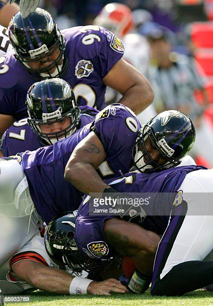 Linebacker Ray Lewis of the Baltimore Ravens recovers a fumble as teammates pile on top during the first half against the Cleveland Browns October...