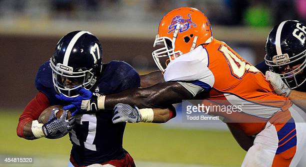 Linebacker Raydell Martin of the Savannah State Tigers can't make the grab on running back Brandan Thomas of the Georgia Southern Eagles during the...