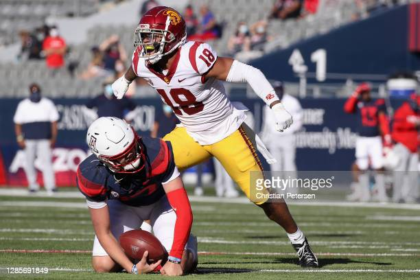 Linebacker Raymond Scott of the USC Trojans celebrates a sack on quarterback Grant Gunnell of the Arizona Wildcats during the first half of the...