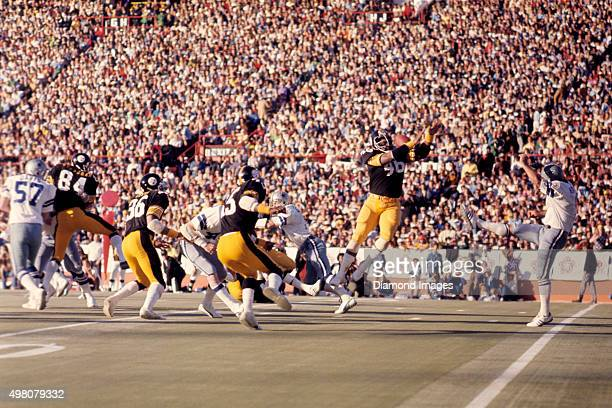 Linebacker Reggie Harrison of the Pittsburgh Steelers blocks a punt by punter Mitch Hoopes of the Dallas Cowboys during Super Bowl X on January 18...
