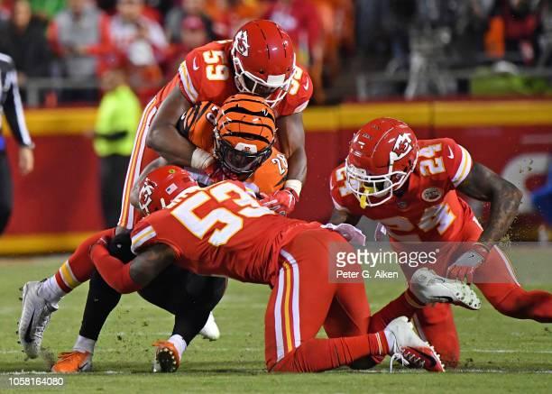 Linebacker Reggie Ragland linebacker Anthony Hitchens and defensive back Jordan Lucas of the Kansas City Chiefs tackle running back Joe Mixon of the...