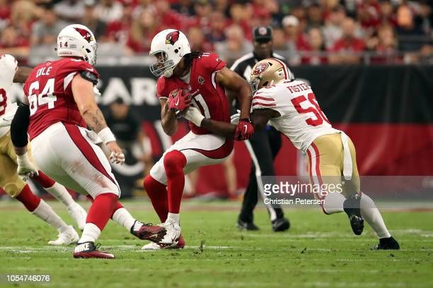 Linebacker Reuben Foster of the San Francisco 49ers tackles wide receiver Larry Fitzgerald of the Arizona Cardinals during the second quarter at...