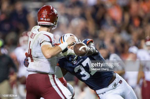 Linebacker Richard Jibunor of the Auburn Tigers knocks the ball out of quarterback Ty Storey of the Arkansas Razorbacks hand in the third quarter at...