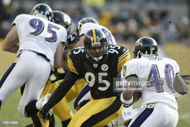 Linebacker Richard Seigler of the Pittsburgh Steelers tries to tackle kick returner Cory Ross of the Baltimore Ravens at Heinz Field on December 24...