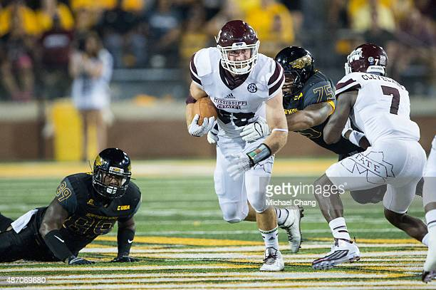 Linebacker Richie Brown of the Mississippi State Bulldogs runs the ball through traffic during their game against the Southern Miss Golden Eagles on...