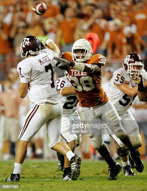 Linebacker Roddrick Muckelroy of the Texas Longhorns pressures quarterback Stephen McGee of the Texas AM Aggies into throwing an incomplete pass in...