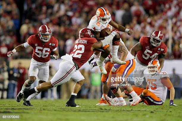 Linebacker Ryan Anderson of the Alabama Crimson Tide attempts to tackle quarterback Deshaun Watson of the Clemson Tigers during the second half of...
