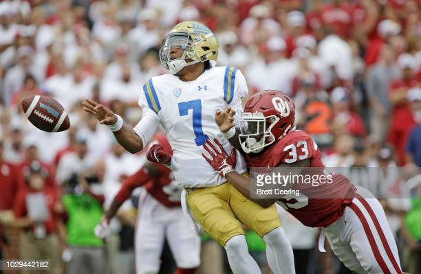 Linebacker Ryan Jones of the Oklahoma Sooners hits quarterback Dorian ThompsonRobinson of the UCLA Bruins just as he pitches back at Gaylord Family...