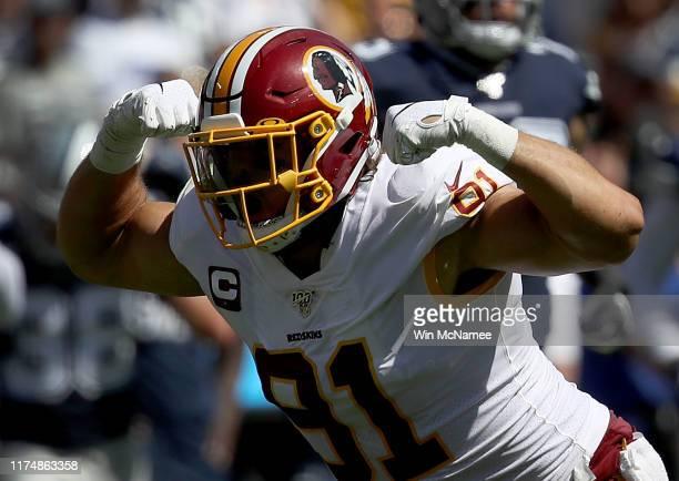 Linebacker Ryan Kerrigan of the Washington Redskins celebrates after sacking quarterback Dak Prescott of the Dallas Cowboys in first half action at...