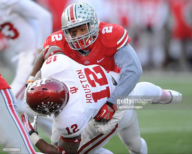 Linebacker Ryan Shazier of the Ohio State Buckeyes tackles running back Stephen Houston of the Indiana Hoosiers during a game against the Indiana...
