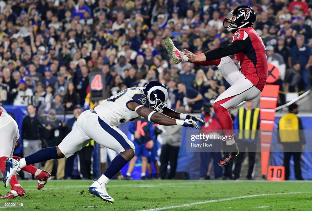 Linebacker Samson Ebukam #50 of the Los Angeles Rams charges punter Matt Bosher #5 of the Atlanta Falcons of the Atlanta Falcons during the second quarter of the NFC Wild Card Playoff game at Los Angeles Coliseum on January 6, 2018 in Los Angeles, California.