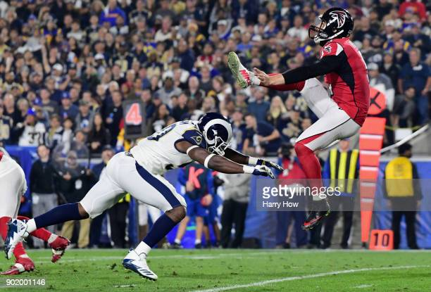 Linebacker Samson Ebukam of the Los Angeles Rams charges punter Matt Bosher of the Atlanta Falcons of the Atlanta Falcons during the second quarter...