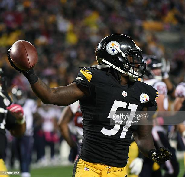 Linebacker Sean Spence of the Pittsburgh Steelers holds the football after recovering a fumble by running back Arian Foster of the Houston Texans...