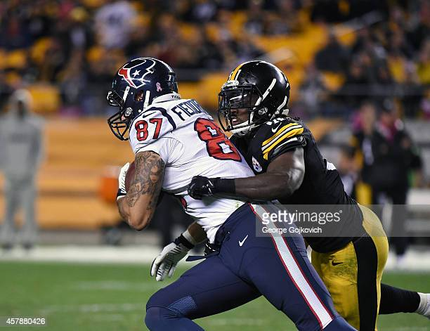 Linebacker Sean Spence of the Pittsburgh Steelers tackles tight end CJ Fiedorowicz of the Houston Texans during a game at Heinz Field on October 20...
