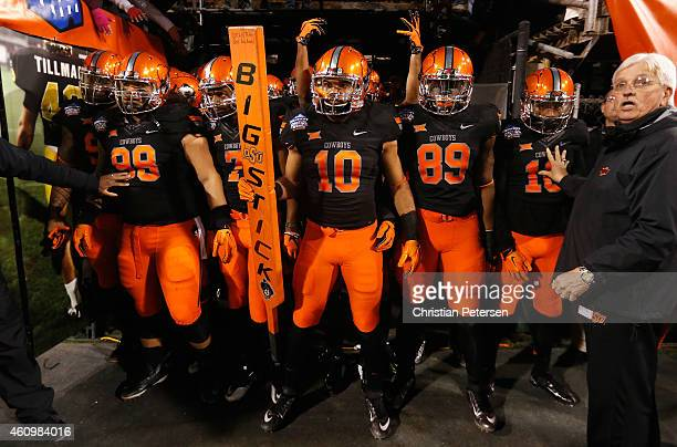 Linebacker Seth Jacobs of the Oklahoma State Cowboys prepares to take the field with teammates for the start of the TicketCity Cactus Bowl against...
