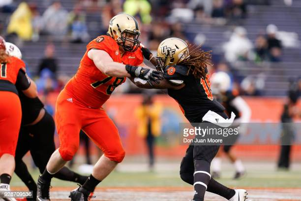 Linebacker Shaquem Griffin from Central Florida on the South Team is being blocked by Tackle Brett Toth from AmyWest Point on the North Team during...