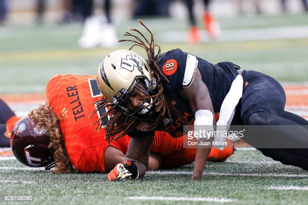 Linebacker Shaquem Griffin from Central Florida on the South Team tackles Guard Wyatt Teller from Virginia Tech on the North Team during the 2018...