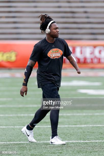 Linebacker Shaquem Griffin from Central Florida on the South Team warms up while listening to music through BEATS headphones before the start of the...