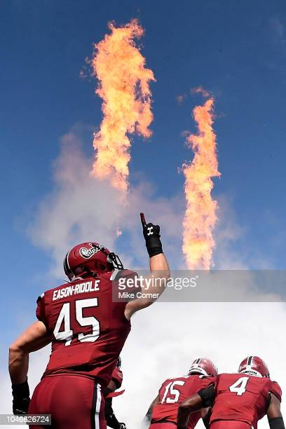 Linebacker Spencer EasonRiddle of the South Carolina Gamecocks points to the sky as he runs on the field for the Gamecocks' football game against the...