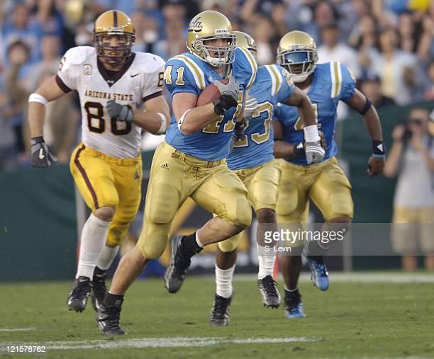 UCLA linebacker Spencer Havner runs back an interception during the Arizona State vs UCLA game at the Rose Bowl in Pasadena CA on Nov 12 2005 UCLA...