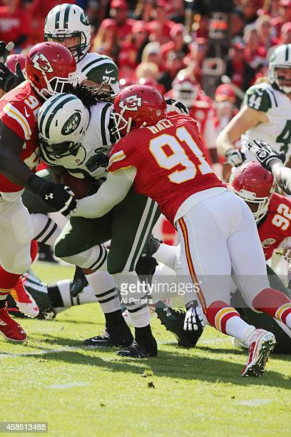 Linebacker Tamba Hali and Defensive Tackle Jaye Howard of the Kasas City Chiefs make a stop of Running Back Chris Ivory of the New York Jets at...