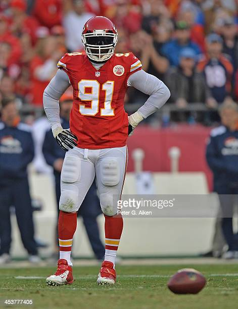Linebacker Tamba Hali of the Kansas City Chiefs looks on before a play against the Denver Broncos during the first half on December 1 2013 at...