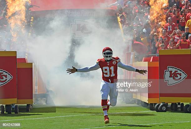 Linebacker Tamba Hali of the Kansas City Chiefs, runs onto the field, as he is introduced before the start of the game against the San Diego Chargers...