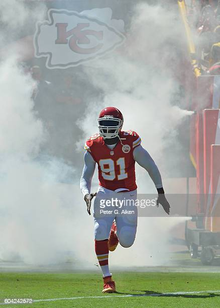 Linebacker Tamba Hali of the Kansas City Chiefs runs onto the field as he is introduced before the start of the game against the San Diego Chargers...