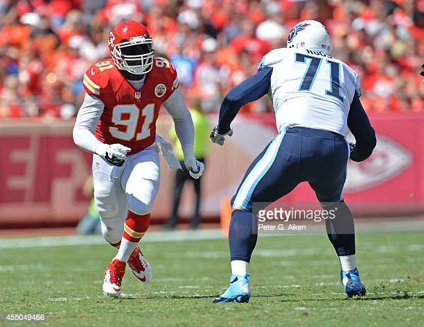 Linebacker Tamba Hali of the Kansas City Chiefs rushes against offensive tackle Michael Roos of the Tennessee Titans during the first half on...