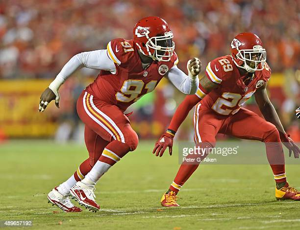 Linebacker Tamba Hali of the Kansas City Chiefs rushes on defense against the Denver Broncos during the first half at Arrowhead Stadium on September...