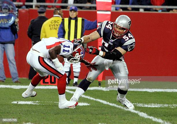 Linebacker Tedy Bruschi of the New England Patriots attempts to tackle wide receiver Roscoe Parrish of the Buffalo Bills at Gillette Stadium October...