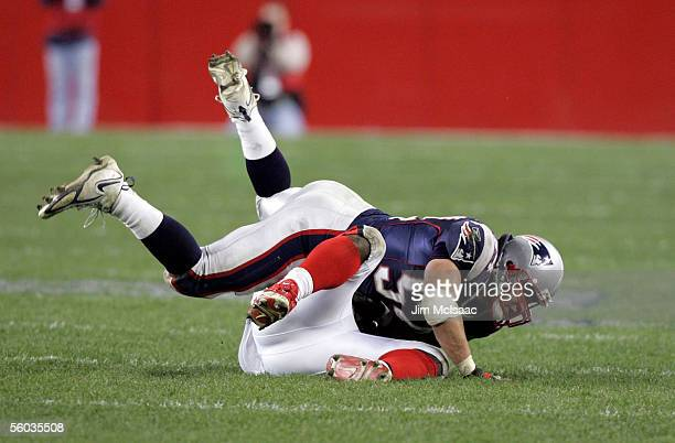 Linebacker Tedy Bruschi of the New England Patriots finishes a tackle on Daimon Shelton of the Buffalo Bills during their game on October 30 2005 at...