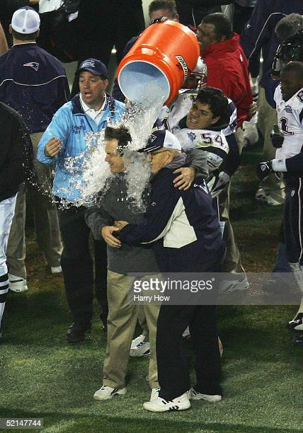 Linebacker Tedy Bruschi of the New England Patriots pours the Gatorade tub over head coach Bill Belichick before defeating the Philadelphia Eagles in...
