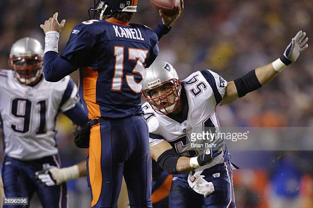 Linebacker Tedy Bruschi of the New England Patriots pressures quarterback Danny Kanell of the Denver Broncos as he throws in the first quarter during...