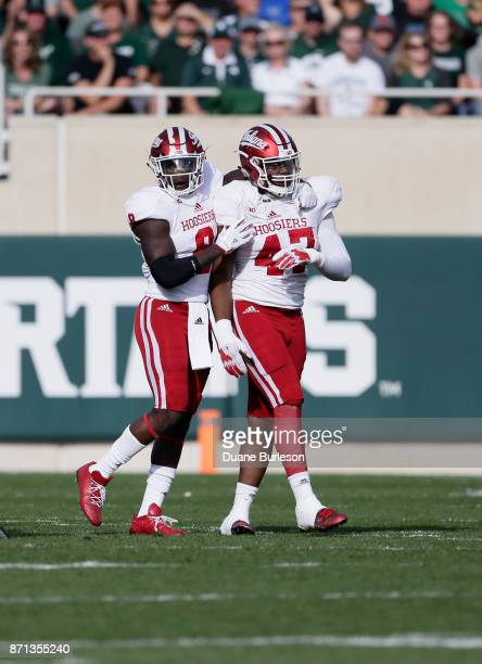 Linebacker Tegray Scales of the Indiana Hoosiers and defensive lineman Robert McCray III of the Indiana Hoosiers during the first half of a game...
