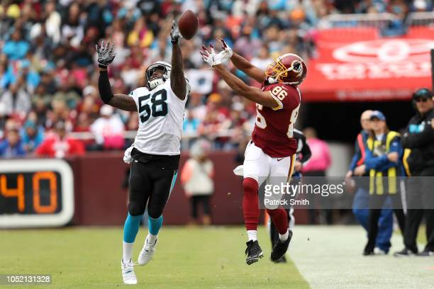 Linebacker Thomas Davis of the Carolina Panthers breaks up a pass to tight end Jordan Reed of the Washington Redskins in the first first quarter at...