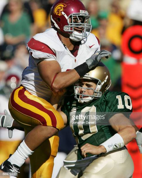 Linebacker Thomas Williams of the University of Southern California Trojans collides with quarterback Brady Quinn of the Notre Dame Fighting Irish...