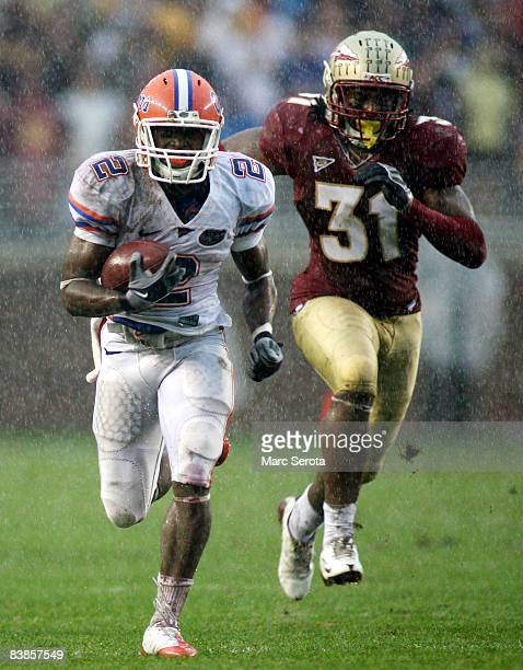 Linebacker Toddrick Verdell of the Florida State Seminoles chases receiver Jeffrey Demps of the Florida Gators during the first half at Bobby Bowden...