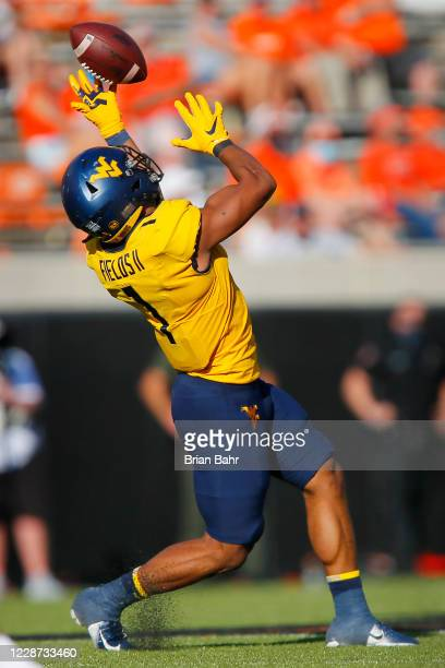 Linebacker Tony Fields II of the West Virginia Mountaineers intercepts a pass from quarterback Shane Illingworth of the Oklahoma State Cowboys for a...