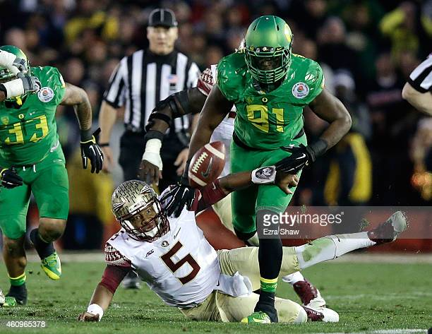 Linebacker Tony Washington of the Oregon Ducks goes to recover a fumble by quarterback Jameis Winston of the Florida State Seminoles for a 58-yard...