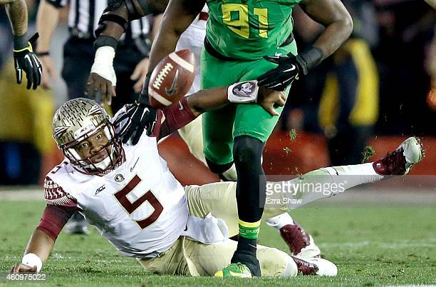 Linebacker Tony Washington of the Oregon Ducks goes to recover a fumble by quarterback Jameis Winston of the Florida State Seminoles for a 58yard...