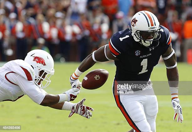 Linebacker TQ Coleman of the Arkansas Razorbacks causes D'haquille Williams of the Auburn Tigers to fumble out of bounds during the game at Jordan...
