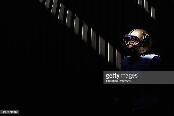 Linebacker Travis Feeney of the Washington Huskies walks out to the field before the college football game against the Arizona State Sun Devils at...