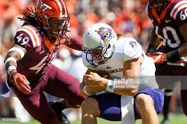 Linebacker Tremaine Edmunds of the Virginia Tech Hokies prepares to hit quarterback Philip Nelson of the East Carolina Pirates in the first half at...