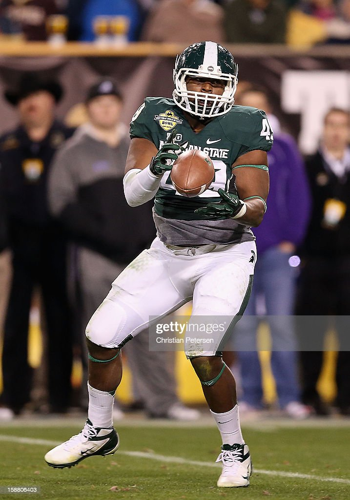 Linebacker TyQuan Hammock #49 of the Michigan State Spartans catches a 29 yard reception against the TCU Horned Frogs during the third quarter of the Buffalo Wild Wings Bowl at Sun Devil Stadium on December 29, 2012 in Tempe, Arizona. The Spartans defeated the Horned Frogs 17-16.