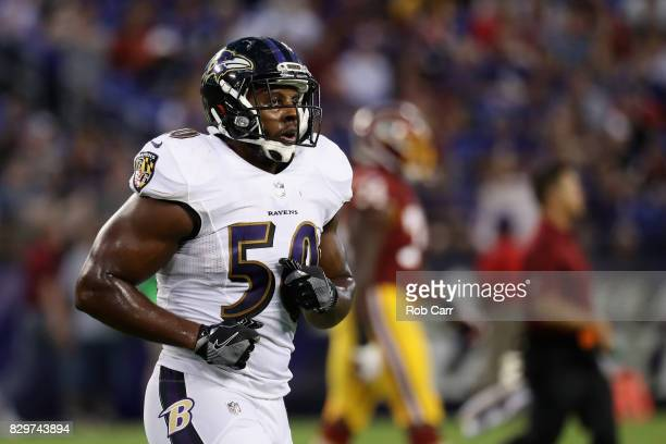 Linebacker Tyus Bowser of the Baltimore Ravens jogs off the field against the Washington Redskins during a preseason game at MT Bank Stadium on...