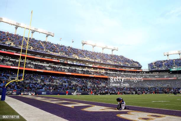 Linebacker Tyus Bowser of the Baltimore Ravens prays in the end zone prior to the game against the Cincinnati Bengals at MT Bank Stadium on December...