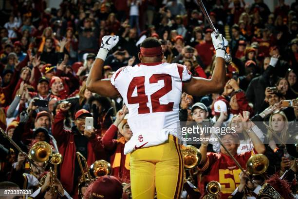 USC linebacker Uchenna Nwosu directs the marching band after the Colorado Buffalos game versus the USC Trojans on November 11 at Folsom Field in...