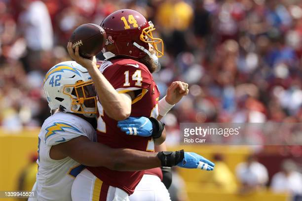 Linebacker Uchenna Nwosu of the Los Angeles Chargers hits quarterback Ryan Fitzpatrick of the Washington Football Team in the second quarter at...