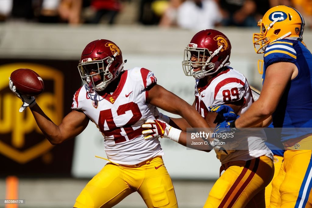 Linebacker Uchenna Nwosu #42 of the USC Trojans celebrates after recovering a fumble during the fourth quarter against the California Golden Bears at California Memorial Stadium on September 23, 2017 in Berkeley, California. The USC Trojans defeated the California Golden Bears 30-20.